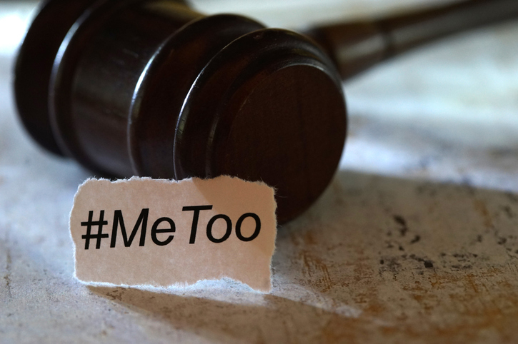 scrap paper reading #MeToo next to gavel
