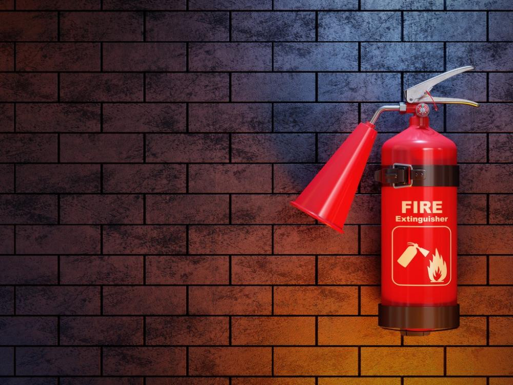 fire extinguisher against dramatic background
