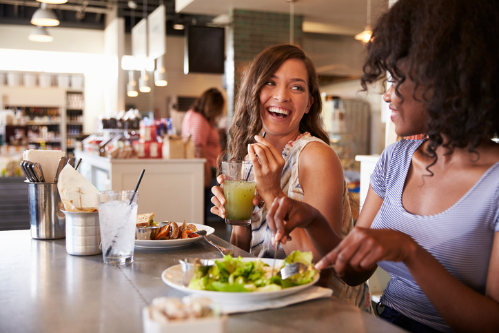 two women enjoying lunch at a restaurant