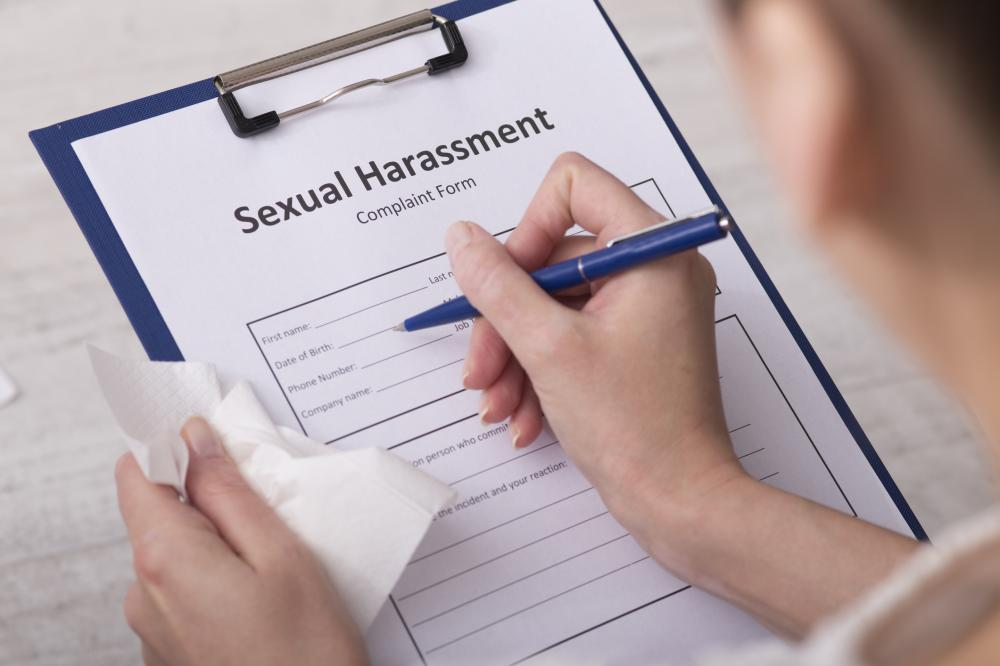 woman filling out a sexual harassment complaint form