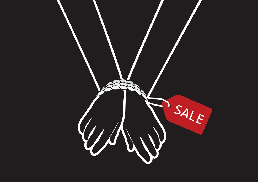 hands bound with rope and sale tag