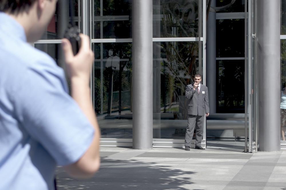 security guards speaking through walkie talkies