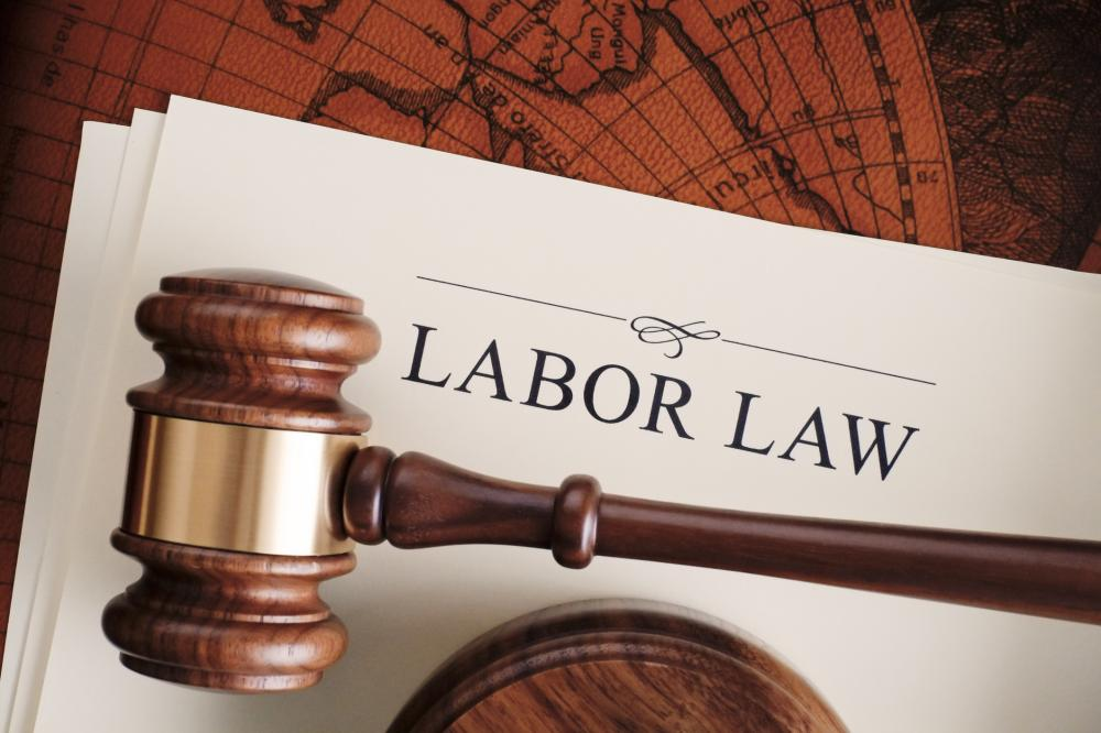 "gavel on top of paper titled ""labor law"""