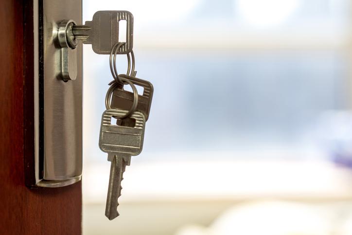 key hanging from door lock
