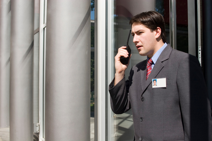hotel security personnel using a walkie talkie