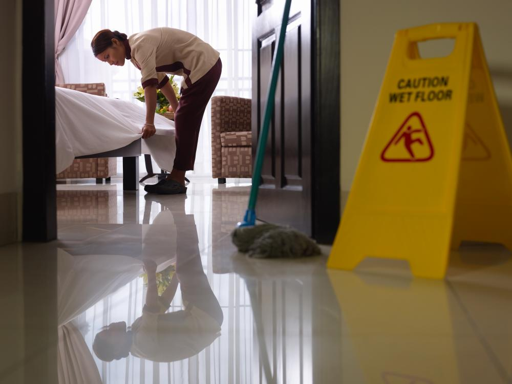 maid at work cleaning luxury hotel room