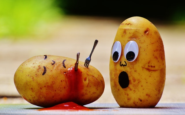 Potato shocked by potato stabbed with utensils