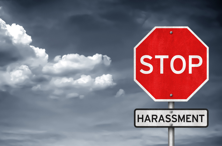 signs reading stop and harassment