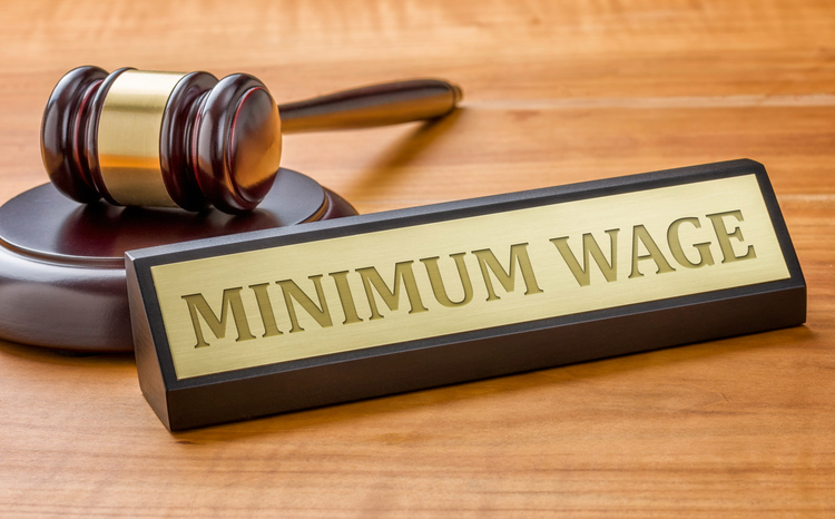 "Gavel and name plate engraved with ""minimum wage"""