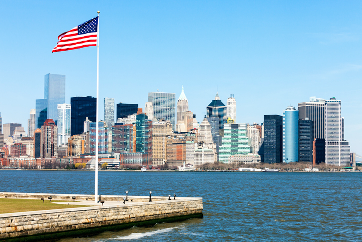 New York skyline with Freedom Tower and US flag