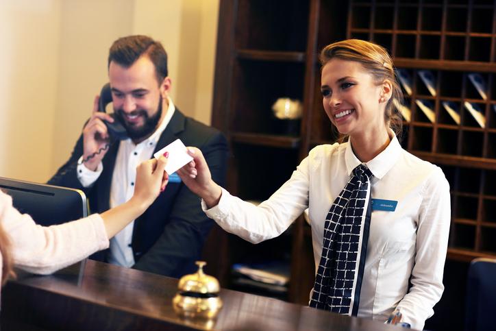hotel security officer speaking into walkie talkie