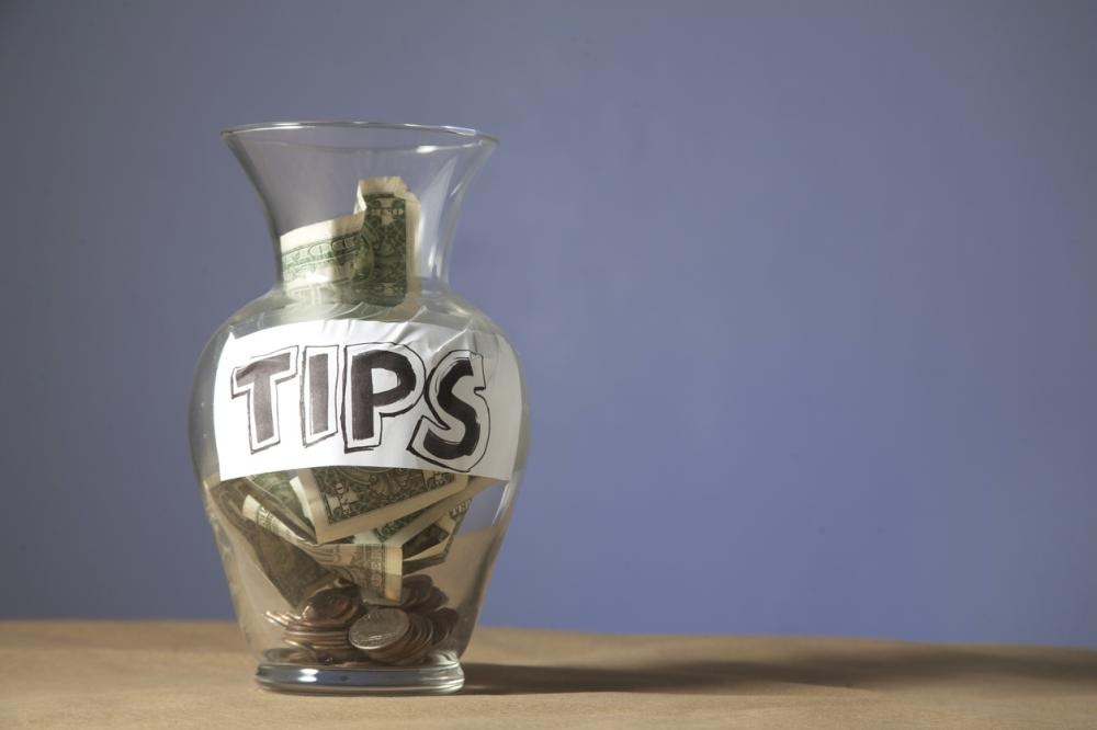 tip jar filled with cash and coins