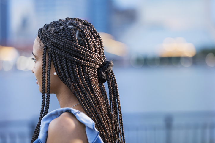 Young mixed race woman with cornrow braids