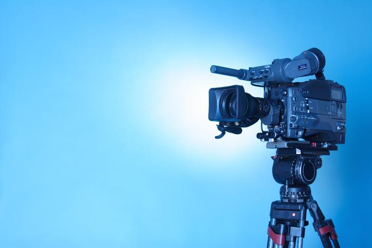 professional TV camera against blue background