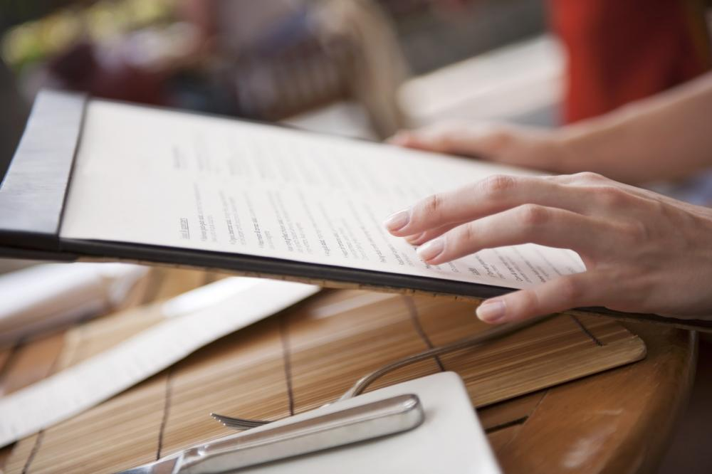 person reading restaurant menu