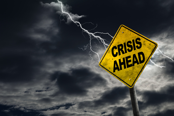 crisis ahead sign with lightning storm background