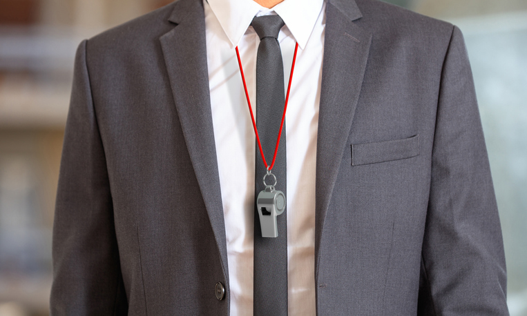 businessman wearing whistle tied with red rope