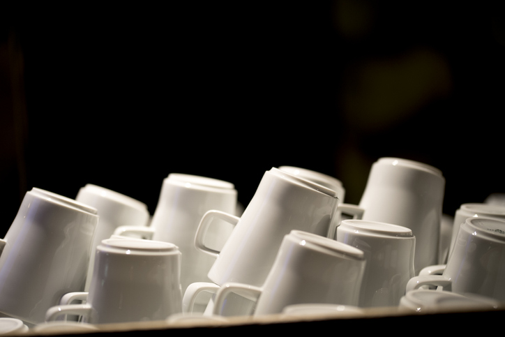 stacks of white mugs