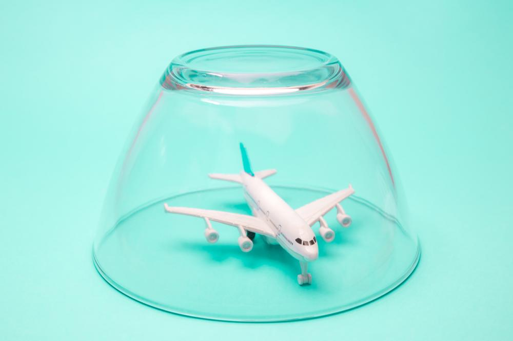 Airplane in isolation quarantine under glass bowl