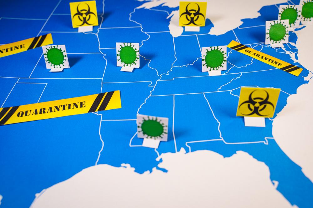 Map of united states with coronavirus and quarantine signs
