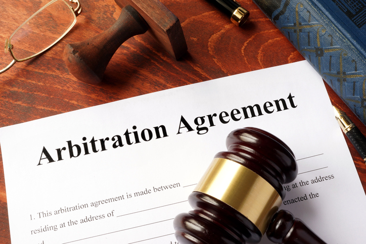 arbitration agreement document and gavel