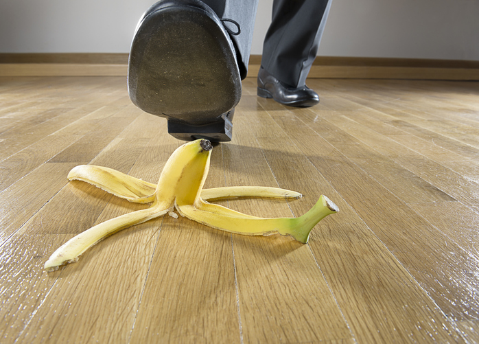 man about to slip on banana peel