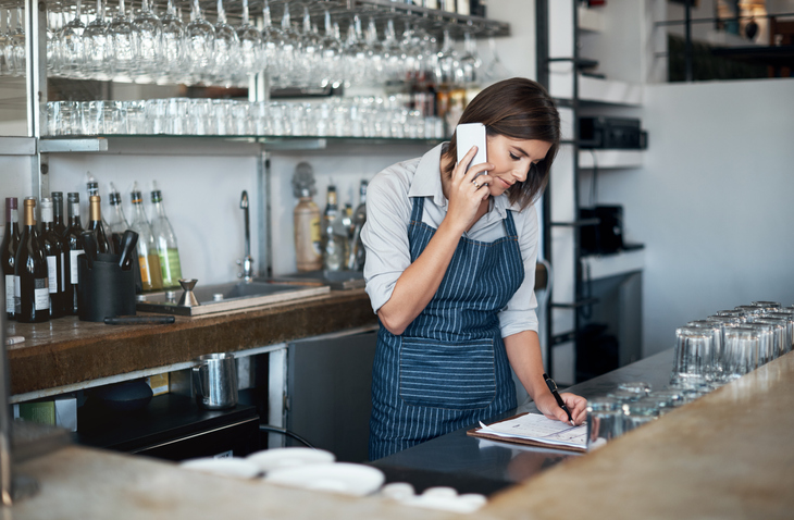 restaurant worker on cell phone call
