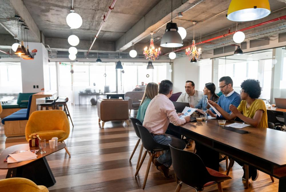 group of casual businesspeople in co-working space