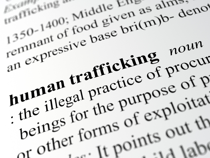 close up definition of human trafficking
