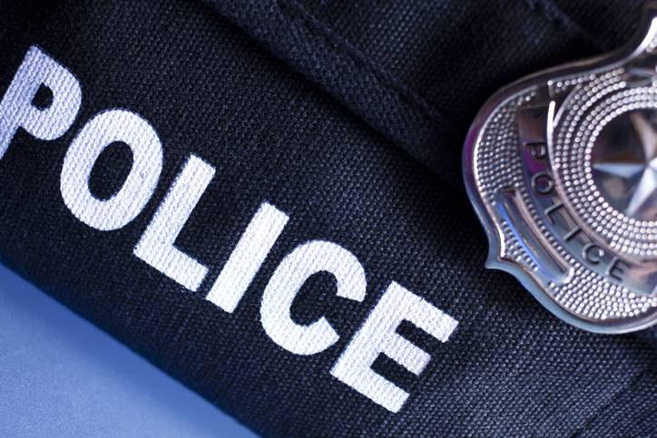 close up of police bulletproof vest and badge
