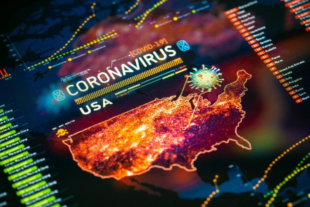 Coronavirus (COVID-19) Outbreak in USA Statistics close-up on digital display.