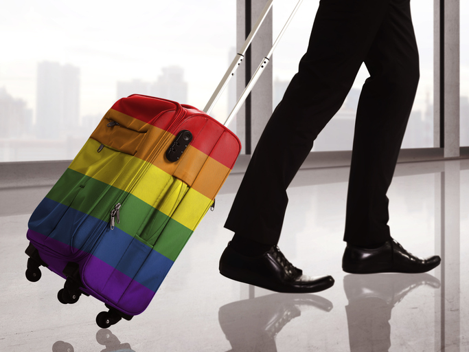 traveler with lgbt rainbow suitcase