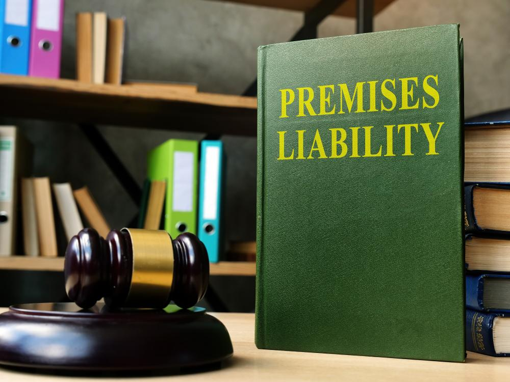 Premises liability laws book for personal injury cases on the shelf.