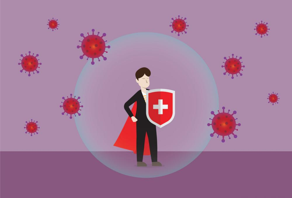 businessperson with shield and cape is protected from bacteria