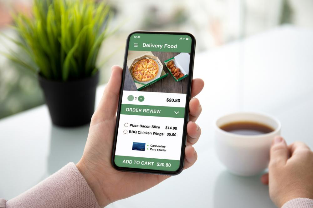 woman ordering food through delivery app