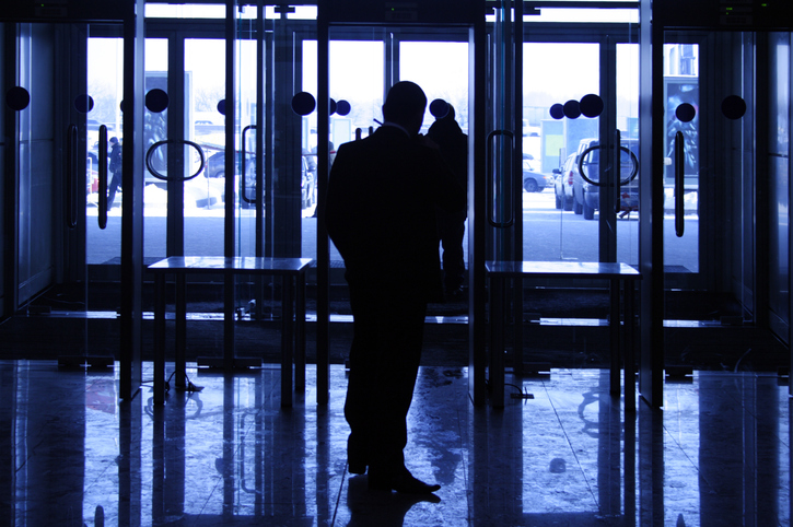 silhouette of security guard at hotel entrance