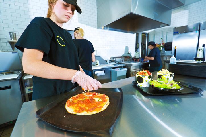 fast-food restaurant worker preparing food