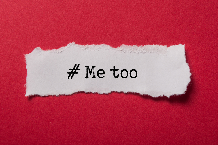 """scrap of paper on red background, reading """"#Metoo"""""""