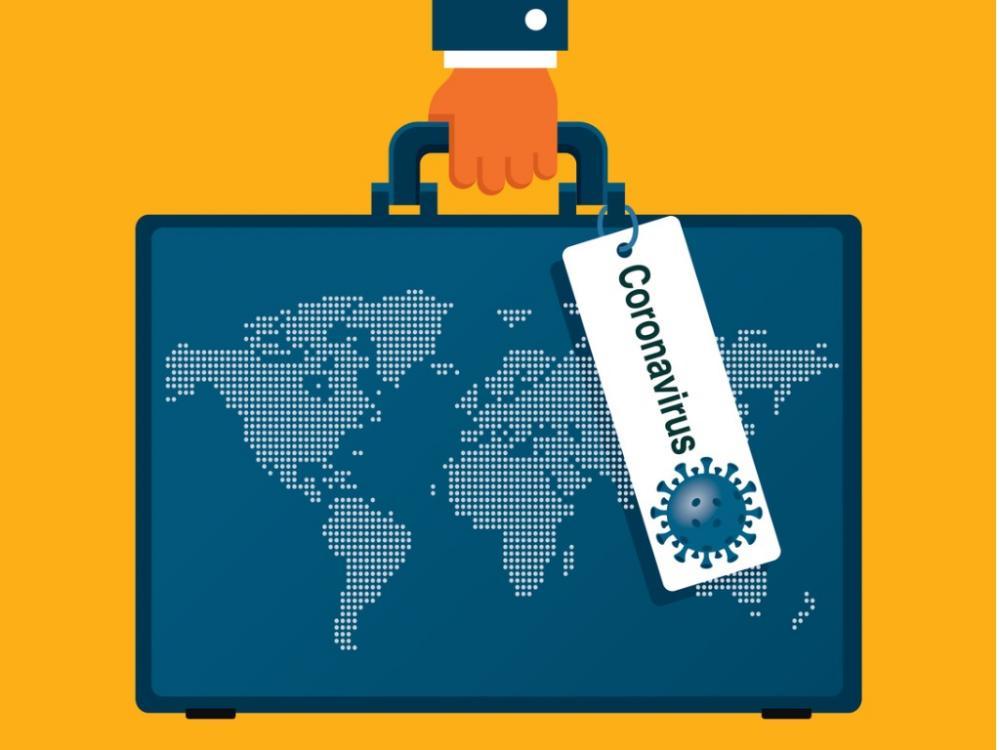 world map on suitcase with coronavirus tag