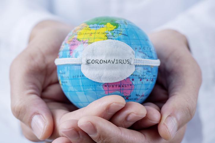 globe with mask reading coronavirus