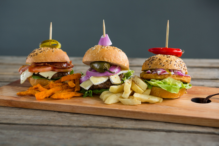 three burgers held together by toothpicks