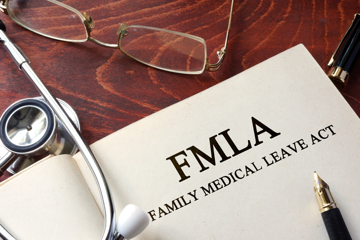 Page with FMLA family medical leave act on a table