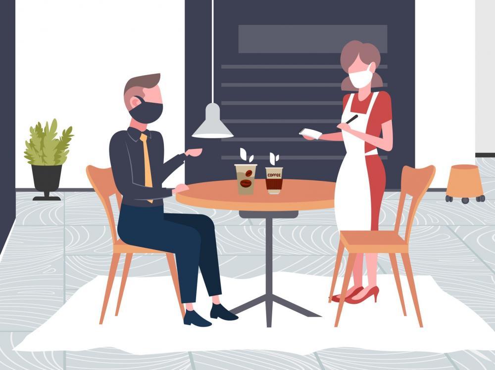 restaurant customer and waitress interact while wearing masks
